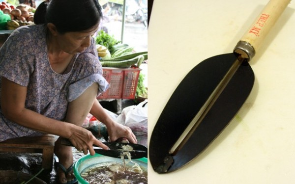 A vendor at the market deftly shaves a banana blossom into thin slices